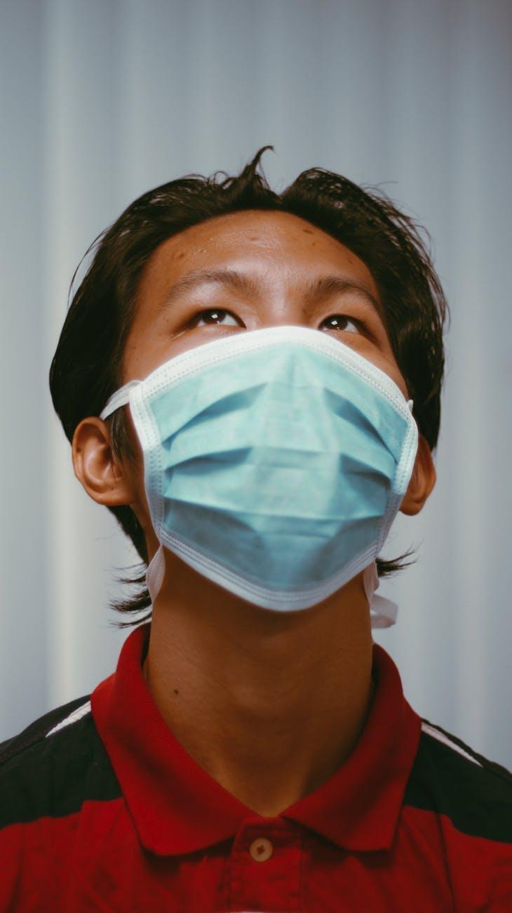 man in red shirt wearing mask